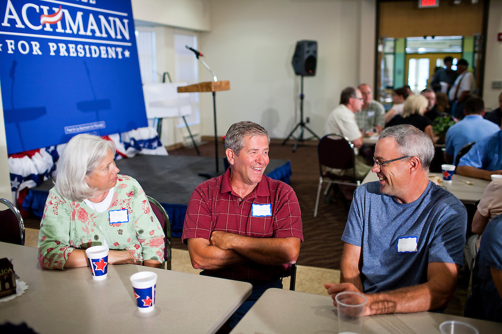 Jane Spencer, Mike Spencer, and Gary Hildreth, from left, await a campaign appearance by Republican presidential candidate Rep. Michele Bachmann (R-MN) at a Calhoun County Republican Party dinner on Monday, August 8, 2011 in Rockwell City, IA.