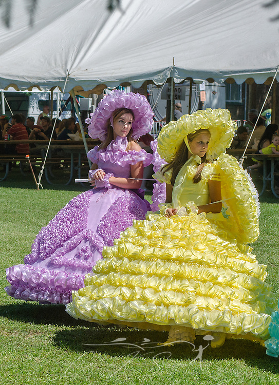 Azalea Trail Maids pose for pictures at the 66th annual Blessing of the Fleet in Bayou La Batre, Alabama, May 3, 2015. The first fleet blessing was held by St. Margaret's Catholic Church in 1949, carrying on a long European tradition of asking God's favor for a bountiful seafood harvest and protection from the perils of the sea. The highlight of the event is a blessing of the boats by the local Catholic archbishop and the tossing of a ceremonial wreath in memory of those who have lost their lives at sea. The event also includes a land parade and a parade of decorated boats that slowly cruise through the bayou. (Photo by Carmen K. Sisson/Cloudybright)