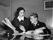 "1954 - Aer Lingus workers Argina Galastegi and Bart Cronin prepare to stage ""Fly way Wild Eagle"""