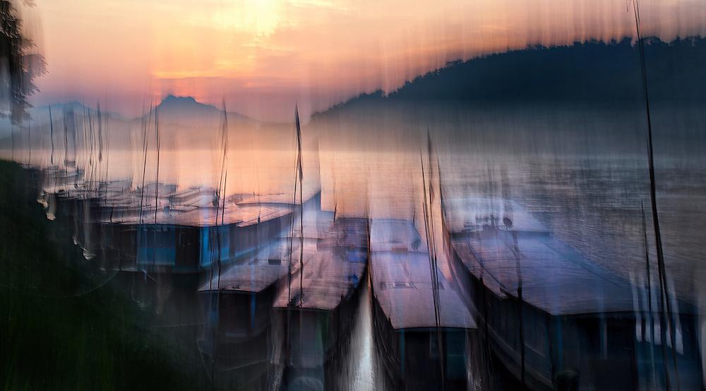 Sunset on the Mekong river in Luang Prabang, Laos.
