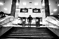 March 2015. Brussels. A man up the stairs on Central train station.