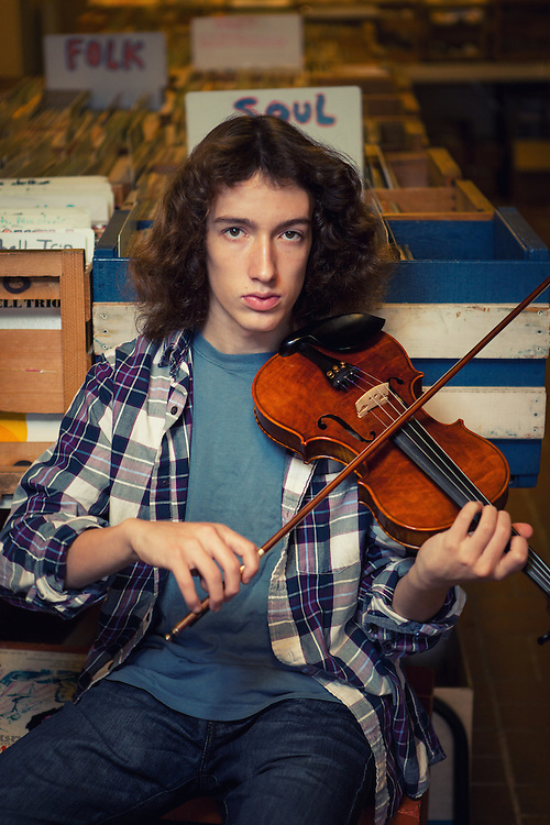 Scott Daniel, member Chicago Youth Symphony Orchestra, State Fair Fiddling Champion and member of Snake Oil Salesman. Promotional shoot.