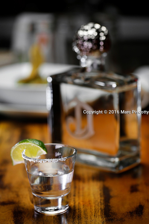 SHOT 10/12/16 7:03:23 PM - A shot of Deleon Platinum tequila with a lime at Latigo Modern Mexican restaurant in the Ballpark neighborhood of Denver, Co. (Photo by Marc Piscotty / © 2016)