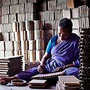 An old woman working inside the factory. Image © Balaji Maheshwar/Falcon Photo Agency
