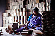An old woman working inside the factory. Image © Balaji Maheshwar/Falcon Photo Agency