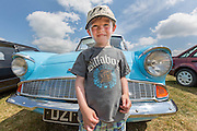 14/7/2013<br /> <br /> Dan Nolan aged 5 from Thomastown Co. Kilkenny with a 1965 Ford Anglia pictured at the Thomastown Classic Steam and Vintage Club Field day at Grennan, Thomastown Co. Kilkenny.<br /> Picture Dylan Vaughan.