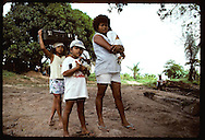 Logger's family totes duck & suitcase after rubber tapprs evicted them in empate of 6/10/89-Xapuri Brazil