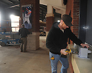 Jeremy Dana (right) and Jay Leonardo of Design & Display install banners of Ole Miss All-American baseball players at Oxford-University Stadium in Oxford, Miss. on Monday, February 11, 2013. 17 banners are being erected and signage in the stadium is being updated.