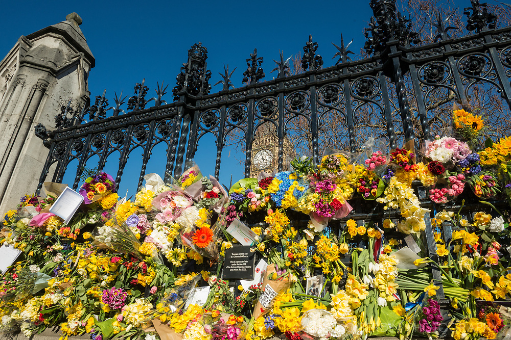 Flowers left in front of the House of Parliament in memory of the policeman stabbed by a terrorist.