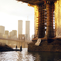 Evening sunlight washes the Manhattan Bridge after a December rainstorm in 2000.
