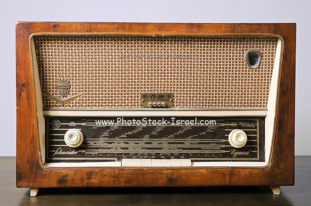 Cutout of a retro Schneider SW radio receiver on white background