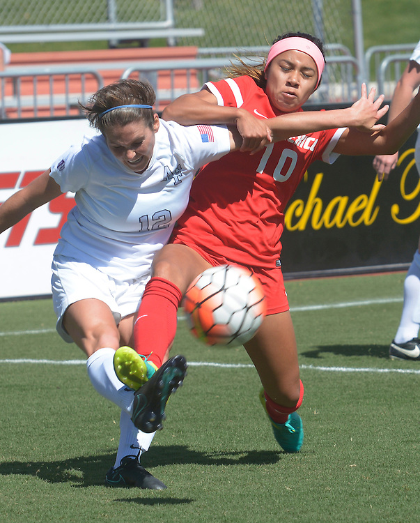 gbs092516p/SPORTS -- Air Force's Meredith Reisinger, left, and UNM's Eileen Zendejas, 10,  grapple for the ball during the game at the UNM Soccer Complex on Sunday, September 25, 2016. Air Force won 2-1.(Greg Sorber/Albuquerque Journal)