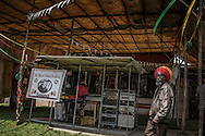 A Rastafarian man helps with the sound check for the reggae concert at The Twelve Tribes of Israel headquarters in Shashemene.  Ethiopia.