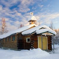 The Kashwitna Community Church sits covered with a fresh snowfall and beneath sunny skies, just south of Talkeetna, Alaska, off the Parks Highway on February 17, 2007.
