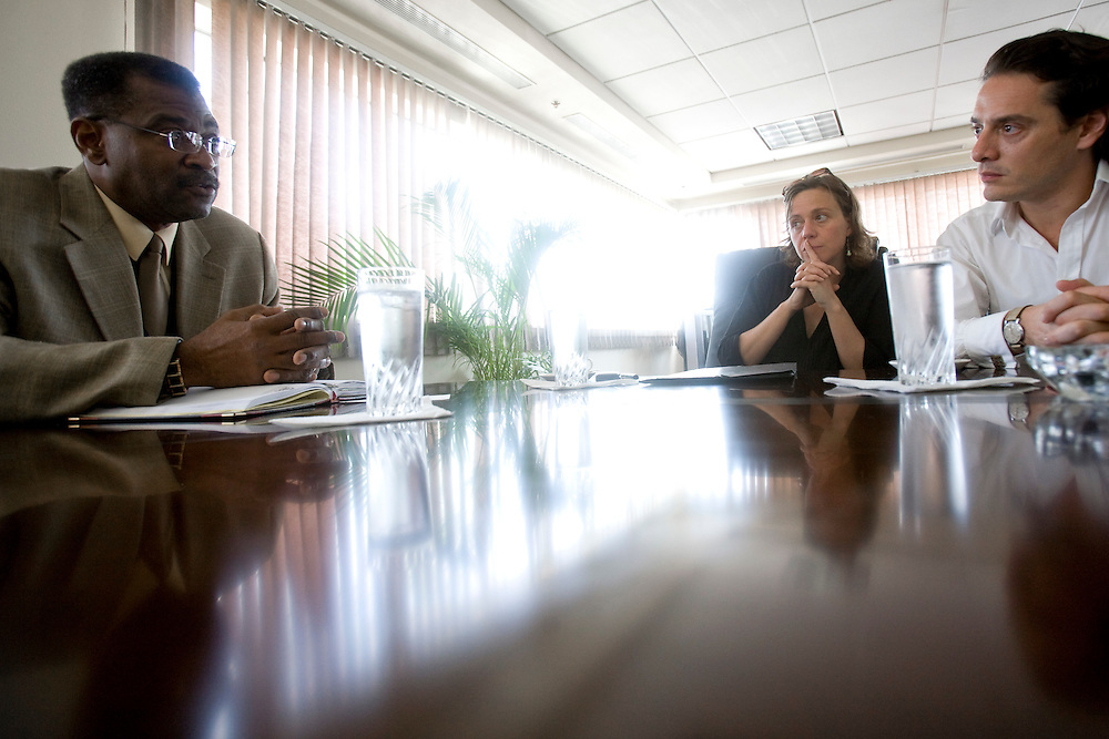 Jude Hervey Day, Head of Cabinet, Emmanuelle Guerry, adopting mother and president of SOS Haiti Enfants Adoptes, and David Koubbi, French lawyer at the Prime Ministers office. Koubbi, a French lawyer, is visiting Haiti to advocate to the Haitian government for passports for 56 children. The children were in the adoption process before the earthquake and though the adoptions have all been finalized, the children need passports before they can join their adopted families in France.
