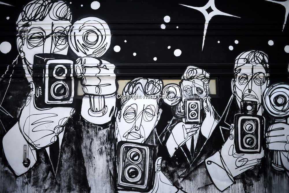 Graffiti portrays a group of paparazzis outside Terroni restaurant, Los Angeles, California.
