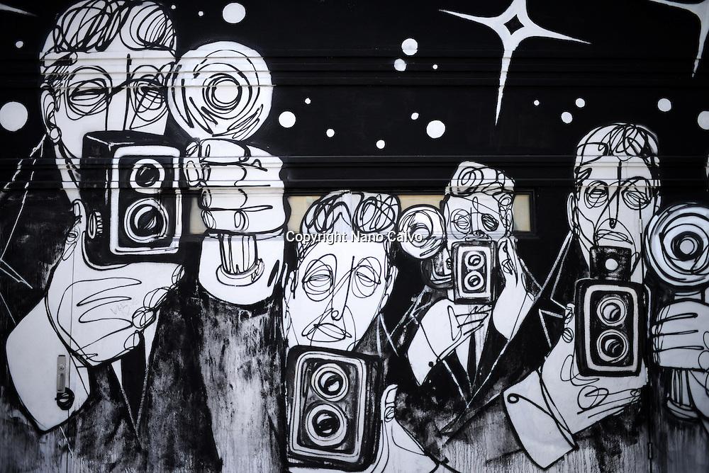 Graffiti portrays a group of paparazzis outside Terroni restaurant, Los Angeles, California.