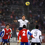 SHOT 3/22/13 7:11:30 PM - United States midfielder Jermaine Jones #13 goes airborne for a head ball against Costa Rica during their World Cup qualifying game at Dick's Sporting Goods Park in Commerce City, Co. on Friday March 22, 2013. The U.S. won the game 1-0 in a spring blizzard that blanketed the pitch and stadium in snow. (Photo by Marc Piscotty / © 2013).