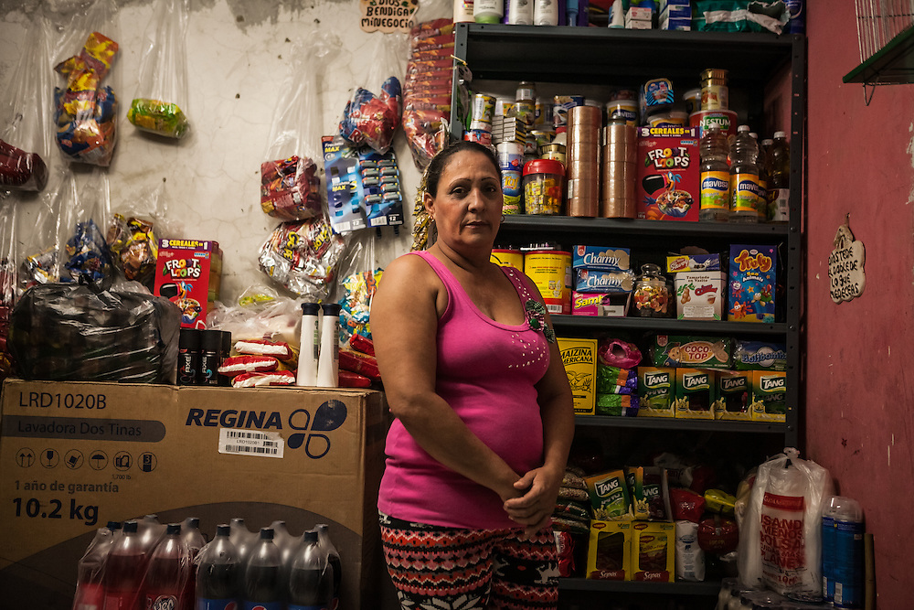 Marta Isabel Caballero Peralta, 45, has lived inside the Tower of David for 7 years. She said she used to be afraid to live there, but eventually she adapted to climbing all the stairs.  Before moving to the tower, she lived in just a room in a slum.  When she arrived at the tower, she cried because she did not want to live here, but says now she likes it.  She has her own business selling food inside the tower now, before moving to the tower she cleaned homes and sold things in the street. She is most proud of her kitchen, where she installed the tile herself. Her favorite thing is having a roof for her entire family, the worst has been the people that have died from falling from top floors, and when they put the tower's leader in prison. PHOTO: Miguel Gutierrez