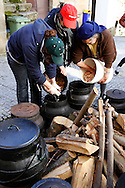 """Women prepare a traditional beans soup for the traditional Celtic carnival """"Caretos"""" in the village of Lazarim, central Portugal on February 17, 2015. PAULO CUNHA /4SEE"""