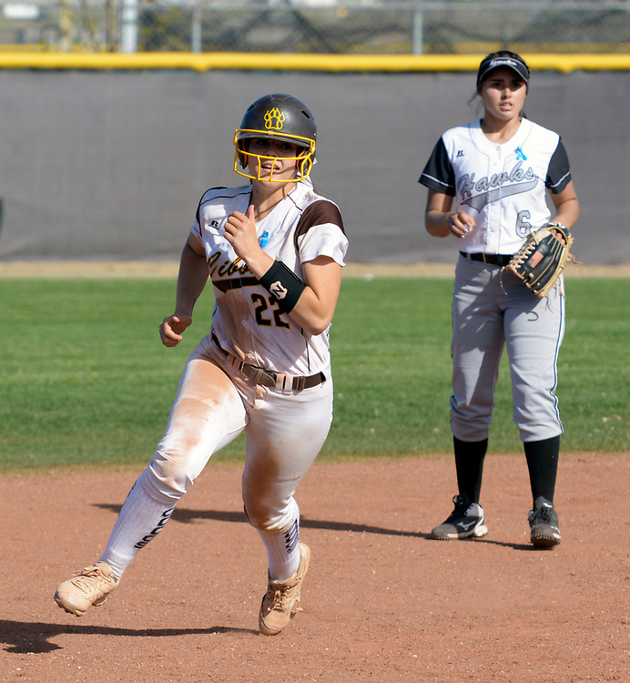 gbs040617w/SPORTS -- Cibola's Samantha Hopkins, 22, rounds second and heads for third base in the second inning of the game against Volcano Vista on Thursday, April 6, 2017. (Greg Sorber/Albuquerque Journal)