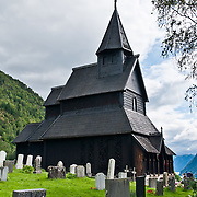 Urnes stavkirke (or stavkyrkje), the oldest Stave Church in Norway, stands at Ornes farm on Lustrafjord in Luster municipality, Sogn og Fjordane county, Norway. The church was built around 1135 AD and links Christian architecture with animal-ornamentation of the Viking Age. In 1979, Urnes Stave Church was listed as a World Heritage Site by UNESCO. Fortidsminneforeningen (Society for the Preservation of Norwegian Ancient Monuments) has owned it since 1881.