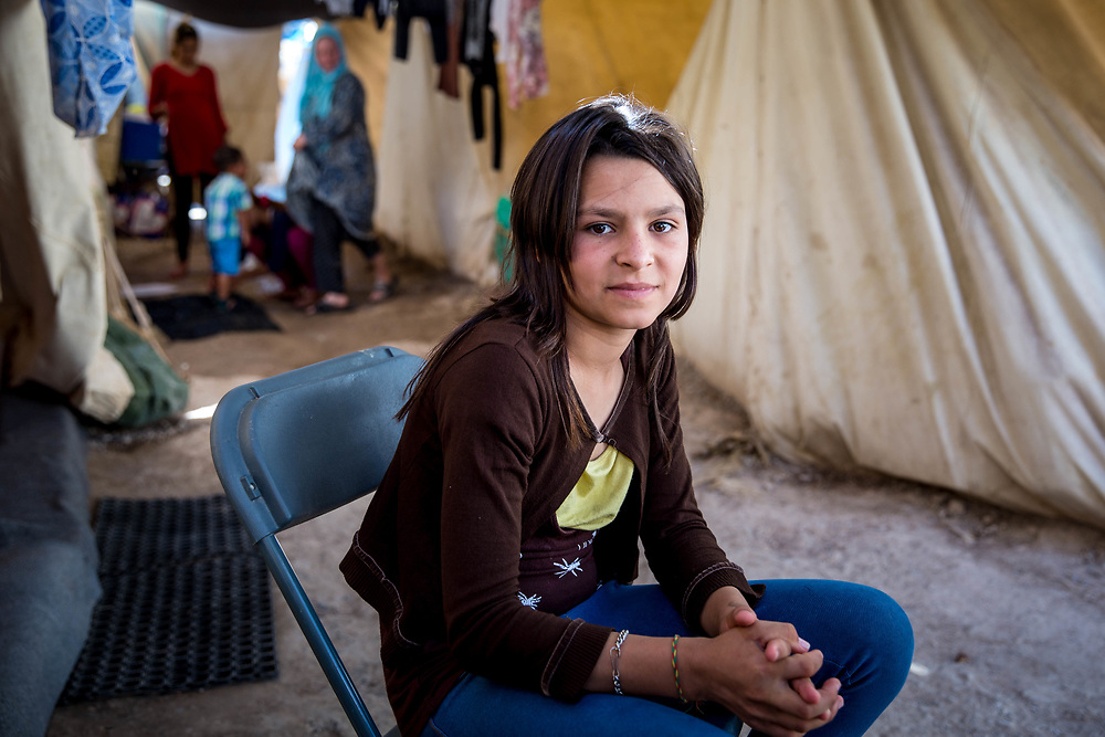 Fatimah, 13, from Aleppo, Syria. She and her family have been stranded in Greece since the Balkan borders were closed to refugees in March 2016. Ritsona, Refugee Camp, Greece, July 2016.