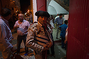 "A Matadores pauses for a moment before entering the bullring at an evening 'Corrida de Touros', on 15th July 2016, at Caldas da Rainha, Portugal. A matador de toros (or ""killer of bulls"" from Latin mactator, killer, slayer, from mactare, to slay) is considered to be both an artist and an athlete, possessing great agility, grace, and co-ordination. The great personal danger of bullfighting adds to the performing matador's mystique; matadores are regularly injured by bulls and, concurrently, 533 professional bullfighters have been killed in the arena since 1700. In the Portuguese version, unlike Spanish bullfights, the bull is not killed. (Photo by Richard Baker / In Pictures via Getty Images)"