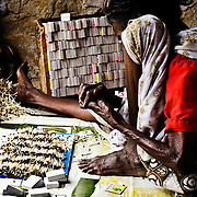 A very old woman working for a meagre wage in a matchstick factory. Image © Balaji Maheshwar/Falcon Photo Agency