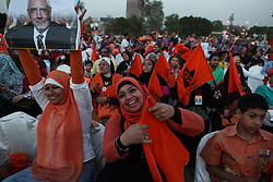 Supporters of Aboul Fotouh ready themselves for the rally, as the sun sets in Cairo..