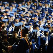 President Thayne M. McCulloh congratulates a graduate during Undergraduate Commencement.<br /> <br /> Photo by Rajah Bose