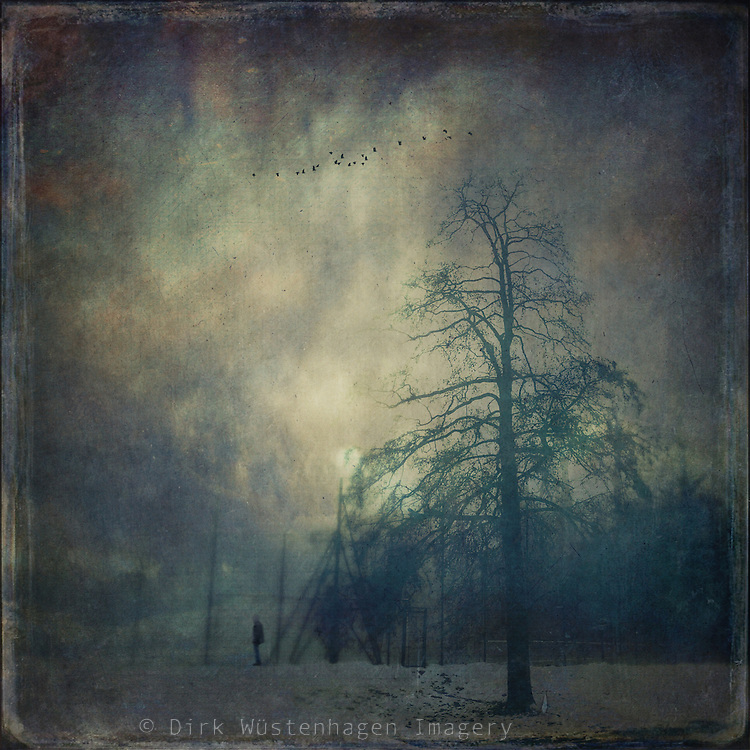 Moody winter scenery with a man standing at a fence...<br />