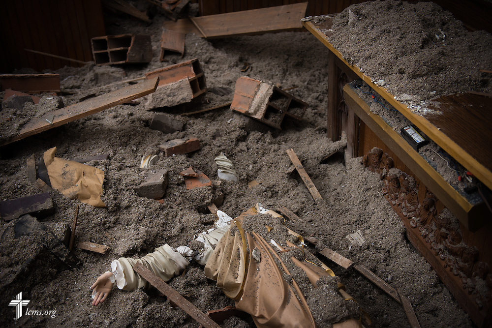 A broken statue of Jesus lies in the rubble of Zion Lutheran Church on Monday, May 11, 2015, in Delmont, S.D. A tornado swept through the area the previous day and destroyed the church and nearby buildings. LCMS Communications/Erik M. Lunsford
