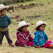 Cute campesino children with hats at Pishgopampa village in Jancapampa Valley. Day 4 of 10 days trekking around Alpamayo, in Huascaran National Park, Cordillera Blanca, Andes Mountains, Peru, South America.