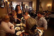 Founder and General Manager Georgette Farkas talking with guests at Rotisserie Georgette in New York, NY on July 08, 2014. The restaurant has an open kitchen framed in beautiful blue-an-white Portuguese tile.
