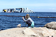Tourist visiting the island to see the Costa Concordia ship wreck