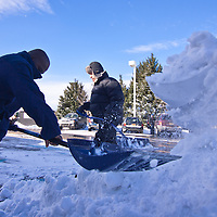 McDonald's General Manager Yves Florespal, left, and owner Robert Cocozzoli shovel snow from the parking at 1788 N.duPont highway in Dover, Monday, Dec. 27, 2010. (AP Photo/The News Journal, Saquan Stimpson)