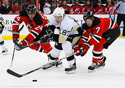 Dec 10, 2008; Newark, NJ, USA; Pittsburgh Penguins center Sidney Crosby (87) skates by New Jersey Devils defenseman Bryce Salvador (24) and New Jersey Devils defenseman Paul Martin (7) during the first period at the Prudential Center.