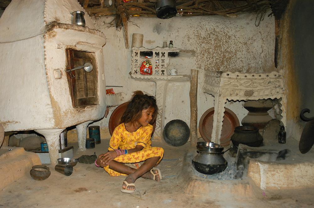 Traditional kitchen in village mud huts, Jaisalmer, Rajasthan, India.