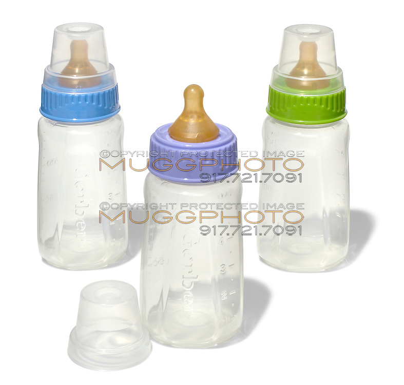 three gerber baby bottles with purple, green and blue lids