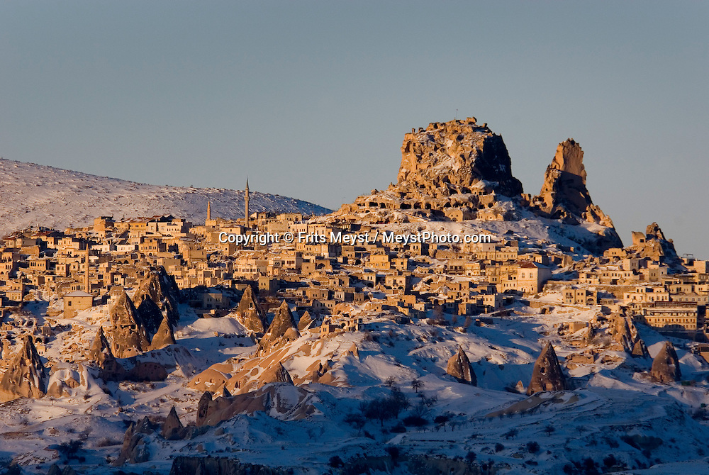 Uchisar, Nevsehir, Cappadocia, Turkey, January 2008. The village of Uchisar towers over the landscape.  With a hot air balloon of Kapadokya Balloons we glide over the valleys of Goreme National Park. A fresh pack of snow has turned the winter landscape into an even bigger fairy tale. Photo by Frits Meyst/Adventure4ever.com
