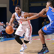 Delaware 87ers Guard JUWAN STATEN (7) drives past Westchester Knicks Guard WESLEY SAUNDERS (32) in the second half of a NBA D-league regular season basketball game between the Delaware 87ers and the Westchester Knicks Tuesday, JAN, 19, 2016 at The Bob Carpenter Sports Convocation Center in Newark, DEL