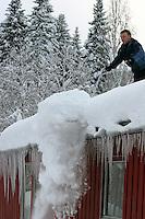 ......Man shoveling the roof