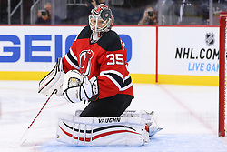 Oct 21, 2014; Newark, NJ, USA; New Jersey Devils goalie Cory Schneider (35) watches the puck after making a save during the first period of their game against the New York Rangers at Prudential Center.