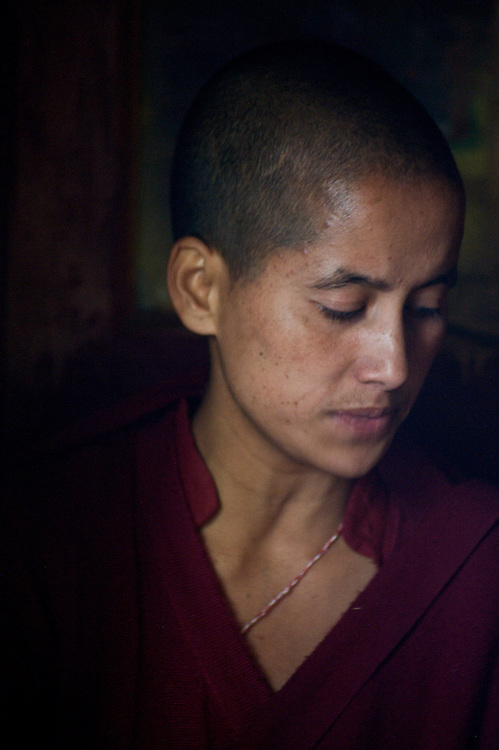 A Buddhist Nun during prayers at Giabong Village, Himachal Pradesh, India