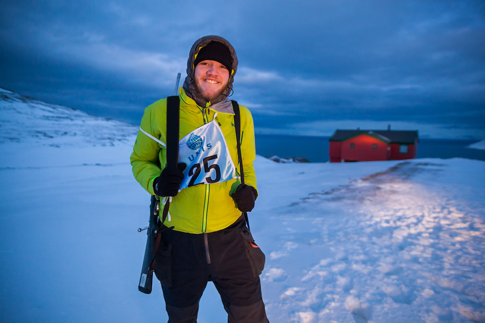 UNIS student Nate Stevens poses with rifles at a shooting range outside Longyearbyen, Svalbard. The university center's basic safety training focuses on polar bear encounters and snowmobile driving.