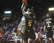 """Ole MIss forward Reginald Buckner (2) shoots as Southern Mississippi forward Torye Pelham (5) defends at C.M. """"Tad"""" Smith Coliseum in Oxford, Miss. on Saturday, December 4, 2010."""