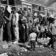 Refugees wait for taking a bus in Hungary right after crossing the border from Serbia, on september 12, 2015. Thousands of refugees, most of them from Syria, cross this border everyday with the hope to reach european countries like Sweden or Germany. The next step for them will be to take that bus in order to register in Hungary before continuing their long journey.