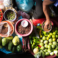 Vegetable seller in Oaxaca's Abastos Market. Mexico