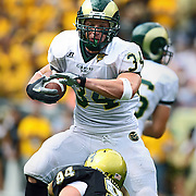 SHOT 9/1/2007 - Colorado State's Kyle Bell (34, RB) looks to avoid the tackle of Colorado's Brandon Nicolas (#94, DT) during the first half of the Rocky Mountain Showdown Saturday September 1, 2007 at Invesco Field in Denver, Co. The University of Colorado won the Centennial Cup with a 31-28 overtime victory in the game. Colorado and Colorado State have met 78 times in their histories, but the first 69 took place on their respective campuses. The Colorado Buffaloes are in the Big 12 Conference, while the Colorado State Rams compete in the Mountain West Conference. Bell rushed 40 times for 135 yards and a touchdown in the game..(Photo by Marc Piscotty © 2007)